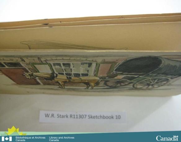 Photographie couleur d'un cahier de dessins, prise en plongée, montrant des taches d'encre sur le bord des pages