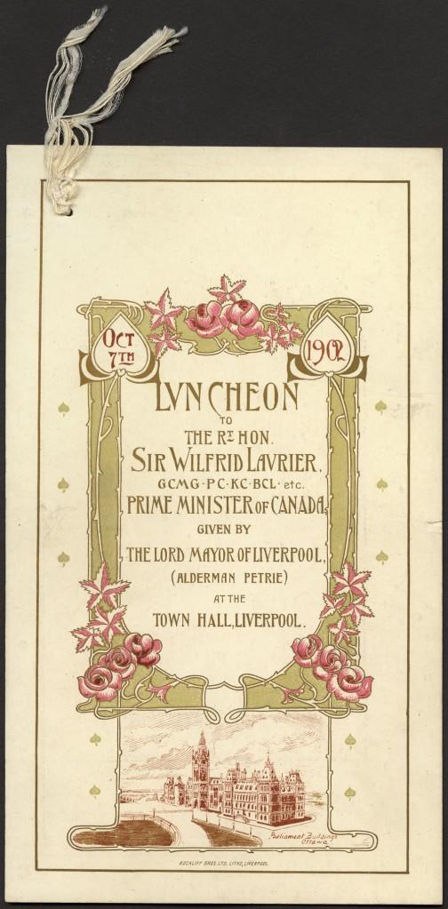 Texte centré, encadré avec soin de lignes dorées et fluides rappelant des tiges de roses, de roses de couleur rose et de feuilles dans les coins inférieurs; sous le cadre, reproduction des édifices du Parlement à Ottawa.