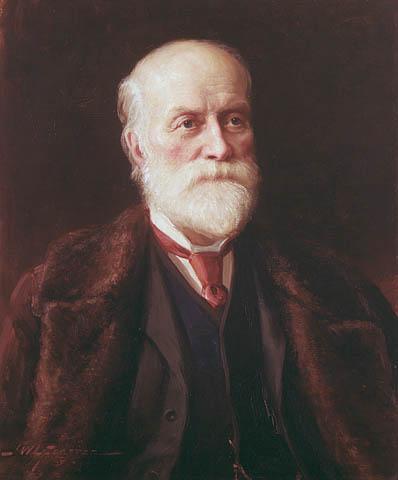 Portrait à l'huile d'un vieil homme à barbe blanche, portant un complet foncé, une cravate rouge et un manteau de fourrure brun.