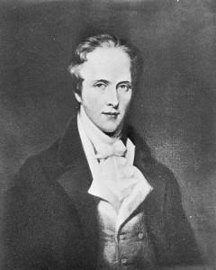 Photo noir et blanc de Thomas Douglas portant une veste noire, un gilet blanc et une cravate blanche.