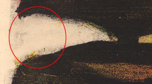 Un gros plan de la bordure montrant la ligne flou de la pierre lithographique