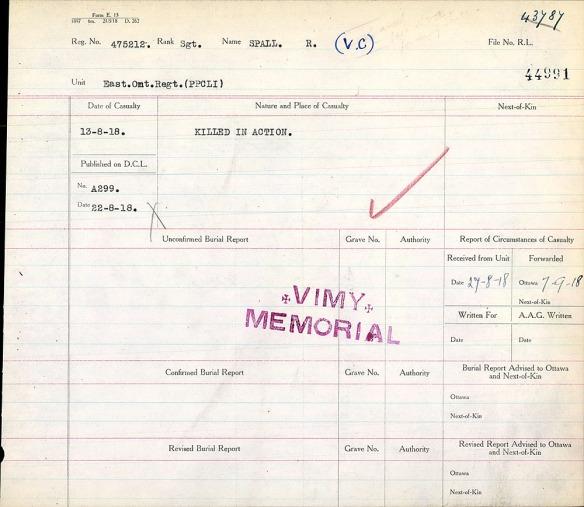 Un document beige avec des cases séparées par des lignes, marqué d'une coche rouge et estampillé « Vimy Memorial » en violet.